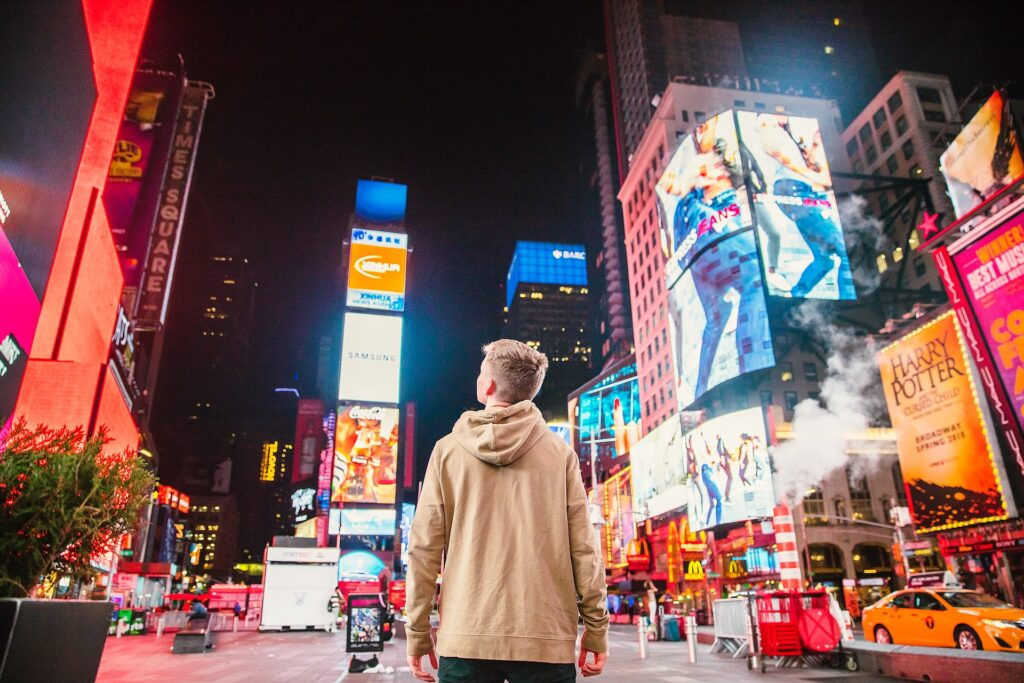 Broadway, young man, ads, New York